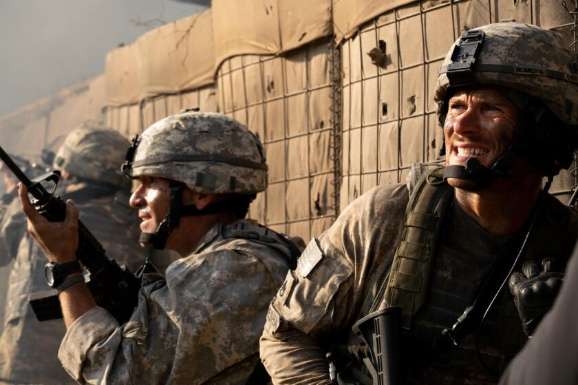 "Scott Eastwood, right, in ""The Outpost."""