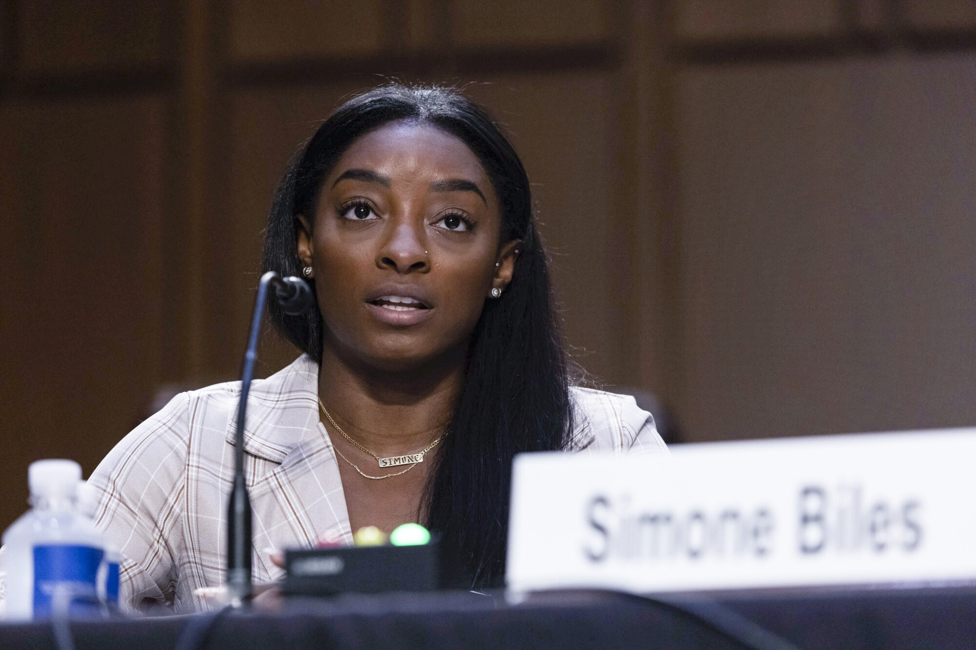 Olympic gymnast Simone Biles testifies on Capitol Hill during a Senate Judiciary hearing.