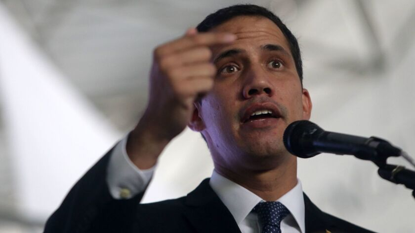 """Venezuelan opposition leader and self-proclaimed interim President Juan Guaido speaks during the presentation of the """"Country Plan"""" in Caracas on March 28, 2019."""