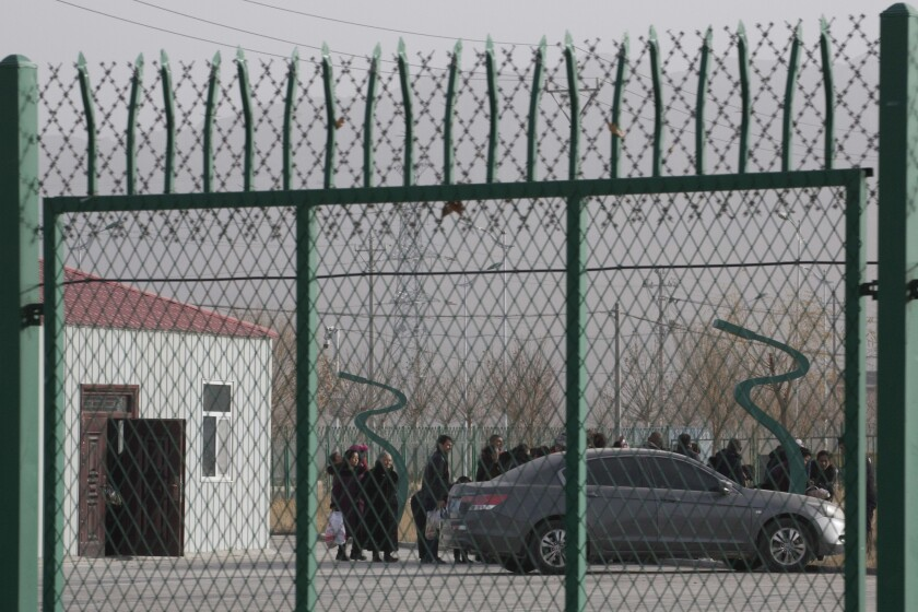 Residents line up inside a forced indoctrination camp in western China's Xinjiang region in December 2018.