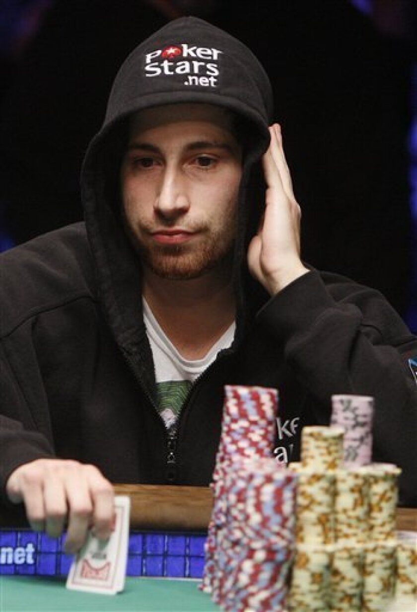 CORRECTS SPELLING OF FIRST NAME--Jonathan Duhamel, of Canada, competes heads-up during the final table of the World Series of Poker, Monday, Nov. 8, 2010 in Las Vegas. (AP Photo/Isaac Brekken)