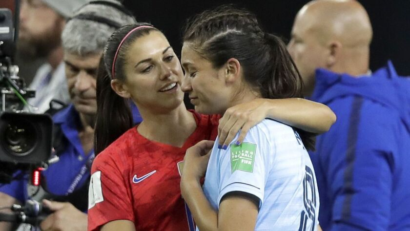 United States' Alex Morgan, left, comforts Thailand's Miranda Nild, right, after the Women's World C