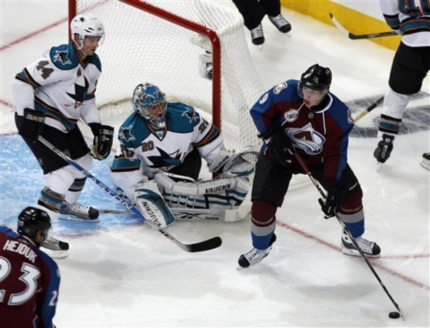 Colorado Avalanche center Matt Duchene, right, feeds the puck to right winger Milan Hejduk, lower left, of the Czech Republic, as San Jose Sharks defenseman Marc-Edouard Vlasic, top left, and goalie Evgeni Nabokov cover the net in the second period of an NHL hockey game in Denver on Thursday, Oct. 1, 2009. (AP Photo/David Zalubowski)