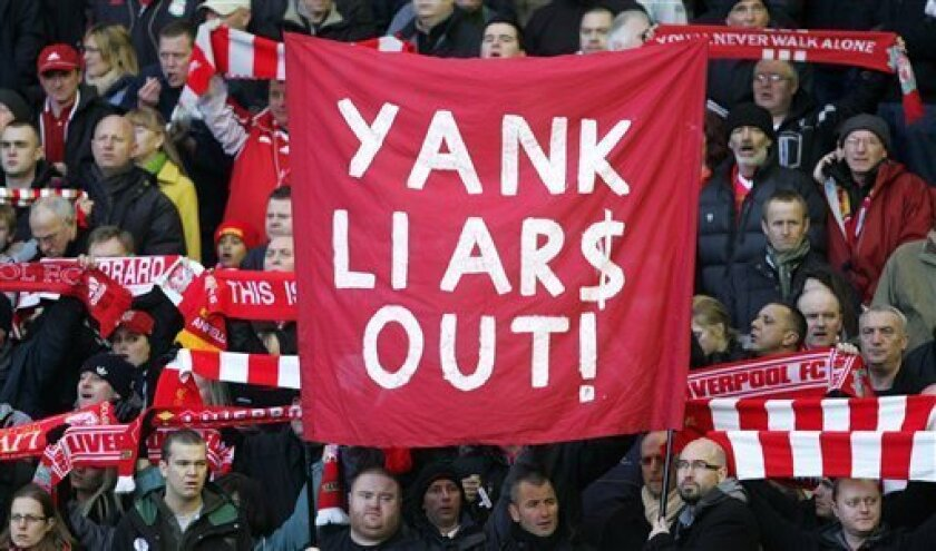 FILE - In this Saturday Jan. 30, 2010 file photo Liverpool fans hold up a banner before the English Premier League soccer match against Bolton at Anfield, Liverpool, England. Liverpool's board agreed to sell the Premier League club to the owners of the Boston Red Sox on Wednesday Oct. 6, 2010, and also announced they will have to take legal action against the existing U.S. owners to force the takeover. (AP Photo/Tim Hales, File)