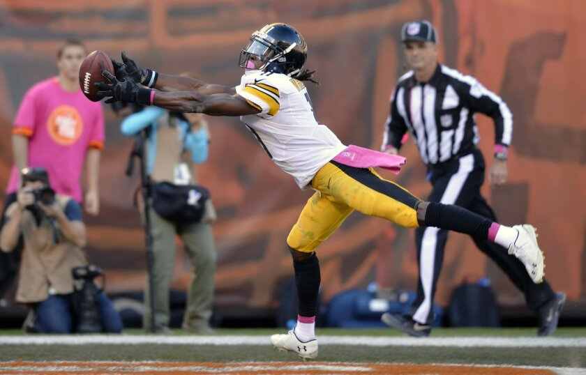 Pittsburgh Steelers wide receiver Markus Wheaton cannot catch a pass in the end zone in the fourth quarter of an NFL football game against the Cleveland Browns, Sunday, Oct. 12, 2014, in Cleveland. (AP Photo/David Richard)