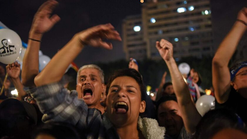Demonstrators demand the resignation of Guatemalan President Jimmy Morales and the renewal of the mandate of an anti-corruption mission of the United Nations in Guatemala City on Sept. 14.