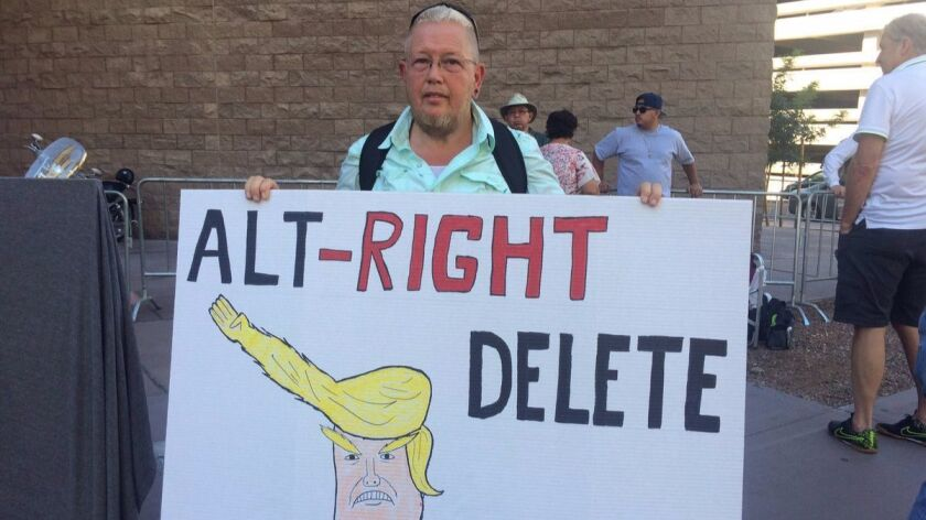 Wolf Schneiter joined protests against President Trump on Tuesday in Phoenix.