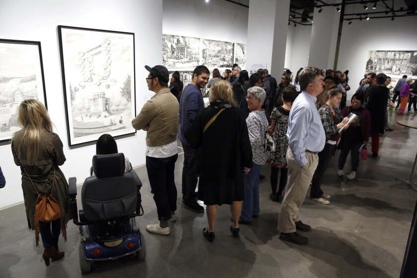 """Attendees peruse the art in November 2016 during the Museum of Contemporary Art San Diego's monthly """"Downtown at Sundown""""."""