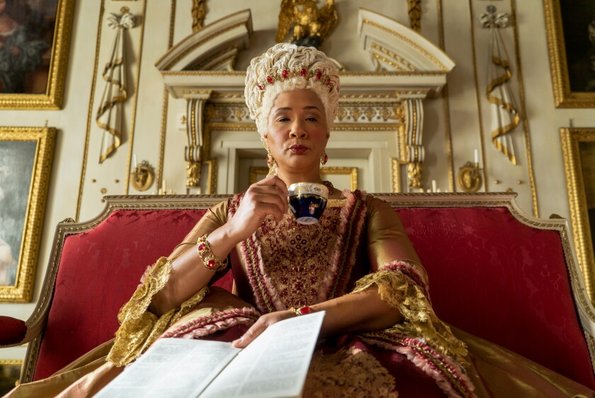"""Golda Rosheuvel as Queen Charlotte looks imperious and drinks tea in an episode of """"Bridgerton."""""""