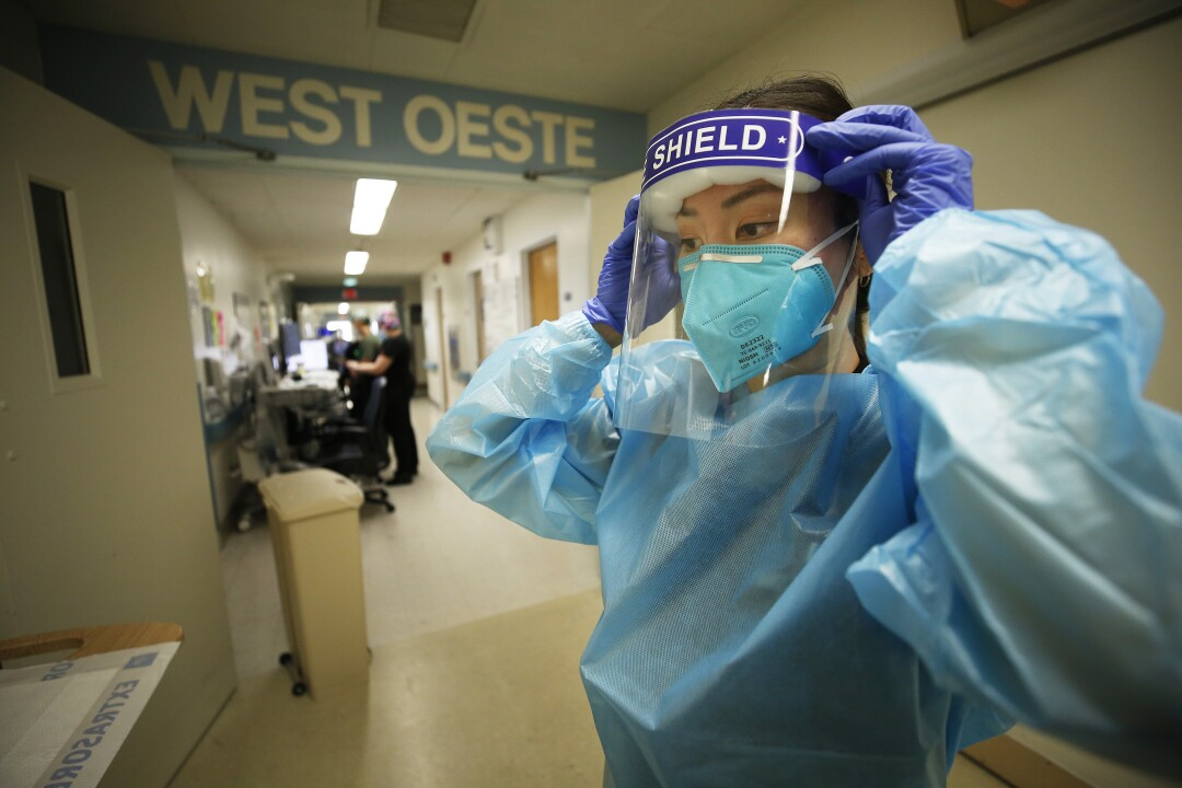 Dr. Christine Choi dons PPE
