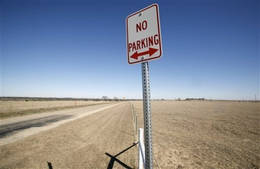 A No Parking sign is seen along Prairie Chapel Road leading to President Bush's ranch near Crawford, Texas, Tuesday, Jan. 13, 2009. The signs were placed along the rural road for security and to discourage protesters while the president was at his 1,600-acre ranch outside town. For the first time i