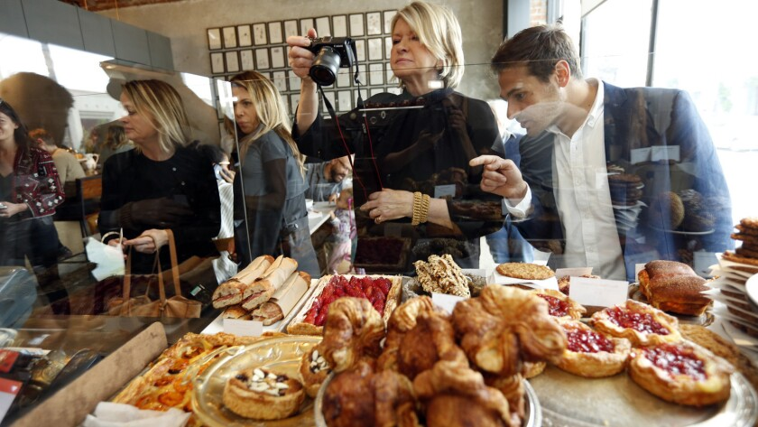Martha Stewart takes a photo of the pastries at Milo and Olive in Santa Monica.
