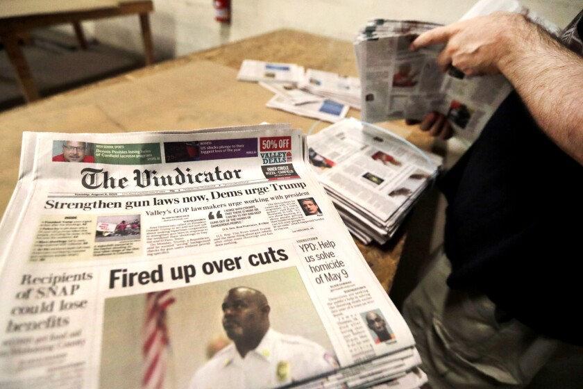 Copies of the Vindicator are readied for delivery at the distribution center in Liberty Township near Youngstown, Ohio.