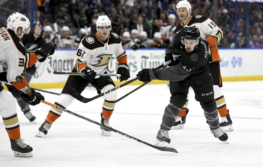 Ducks defenseman Jacob Larsson (32) defends as Tampa Bay Lightning center Cedric Paquette (13) shoots during the second period on Saturday.