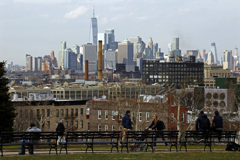 People young and old gather in Sunset Park, which has views of Industry City and of Manhattan.