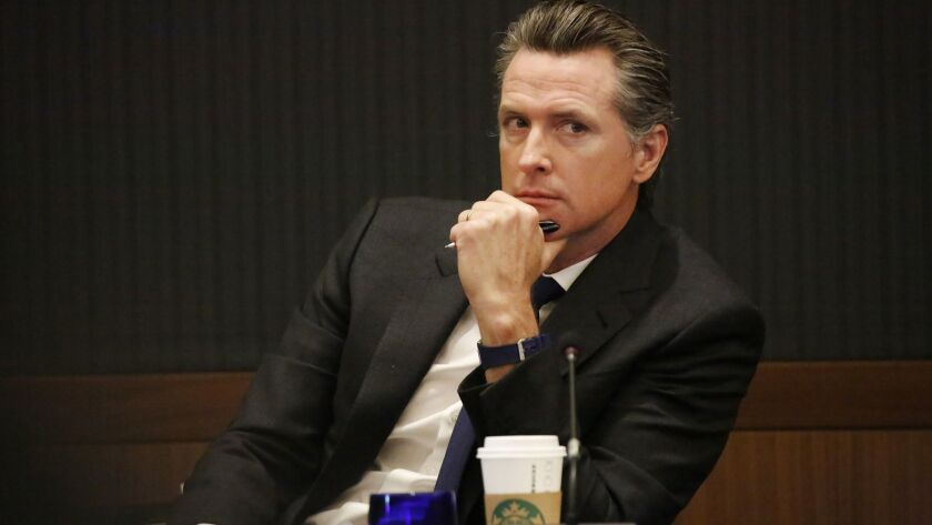 California Lt. Governor and University of California Regent Gavin Newsom listens to speakers during the UC Board of Regents meeting at UCLA on March 14.