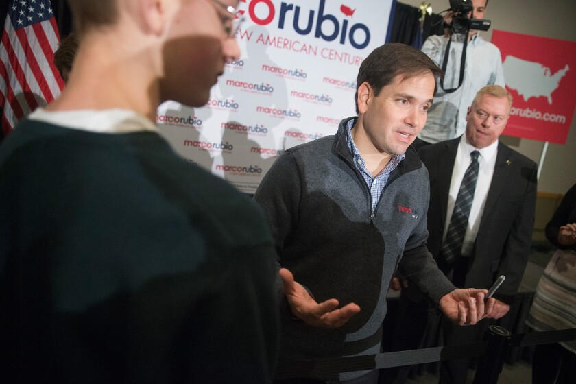 Republican presidential candidate Sen. Marco Rubio of Florida greets guests during a town hall meeting over the weekend in Cedar Rapids, Iowa. His stand on immigration will need to be clarified before the campaign hits the swing states of Colorado and Nevada.