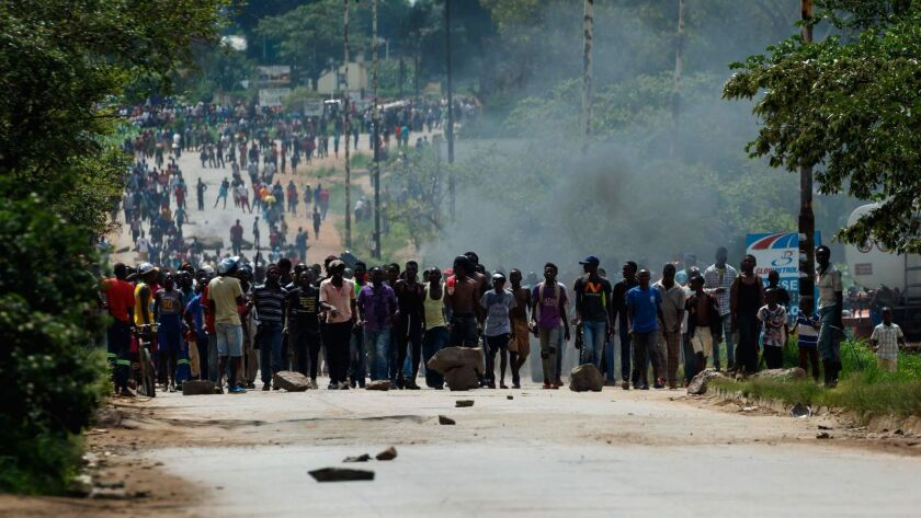 Angry protesters barricade the main route to Harare, the capital of Zimbabwe, after the government more than doubled gas prices.