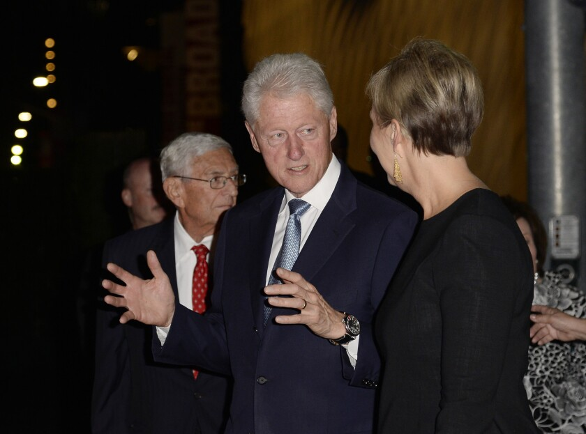 Former President Clinton stands with Joanne Heyler and Eli Broad during the Broad museum's party on Sept. 18.