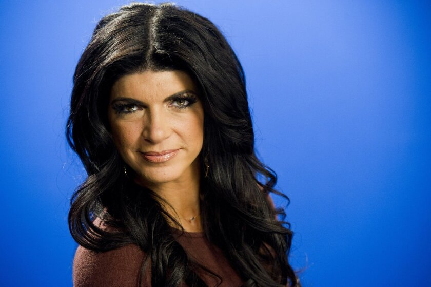 In this Jan. 4, 2012 photo, Teresa Giudice poses for a portrait in New York. Giudice and her husband, Joe, are seeking nearly $4 million for their six-bedroom home in Montville, N.J. The couple are facing federal prison after they pleaded guilty to conspiracy to commit mail and wire fraud and three types of bankruptcy fraud. The stone and stucco home was built in 2008 on a nearly 4-acre lot that includes a stream and a pond. (AP Photo/Charles Sykes)