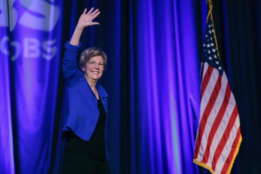 Sen. Elizabeth Warren (D-Mass.) is welcomed to the stage during the Good Jobs Green Jobs National Conference at the Washington Hilton on April 13.