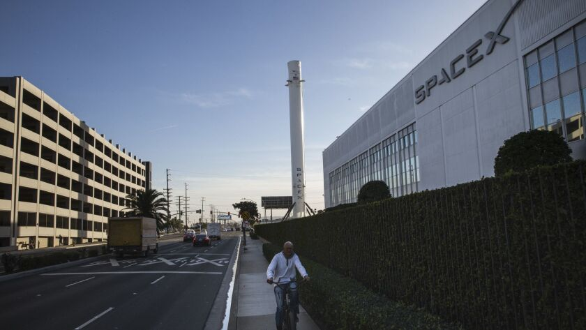 The first rocket booster that SpaceX landed back on Earth stands outside SpaceX's headquarters in Hawthorne.