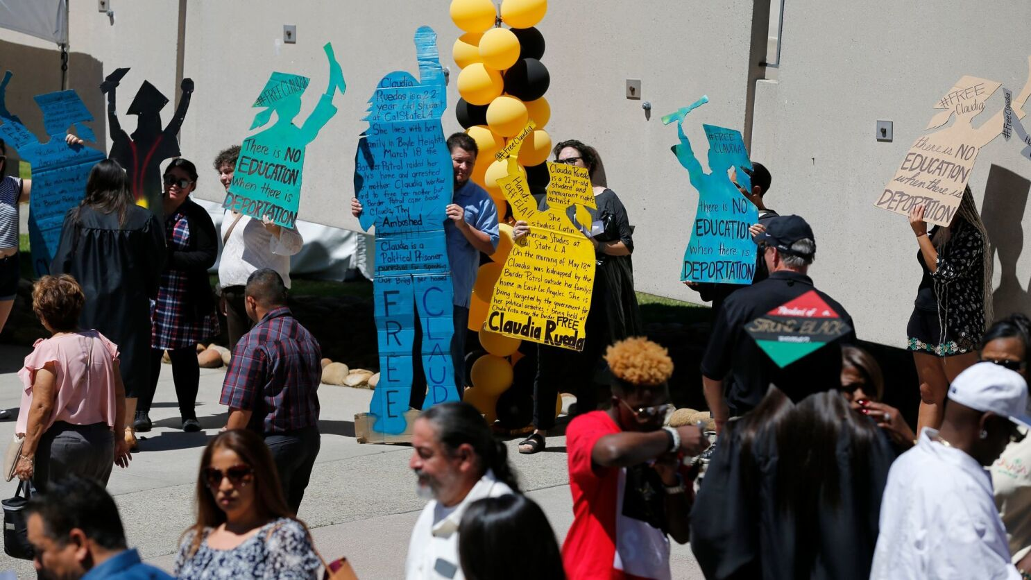 Supporters Of Cal State L A Student Activist Detained By Border Patrol Hold Silent Rally On Commencement Day Los Angeles Times