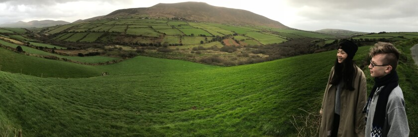 American tourists admire the hills of Dingle Peninsula, County Kerry, Ireland.
