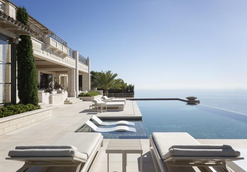 An infinity-edge swimming pool overlooking the ocean