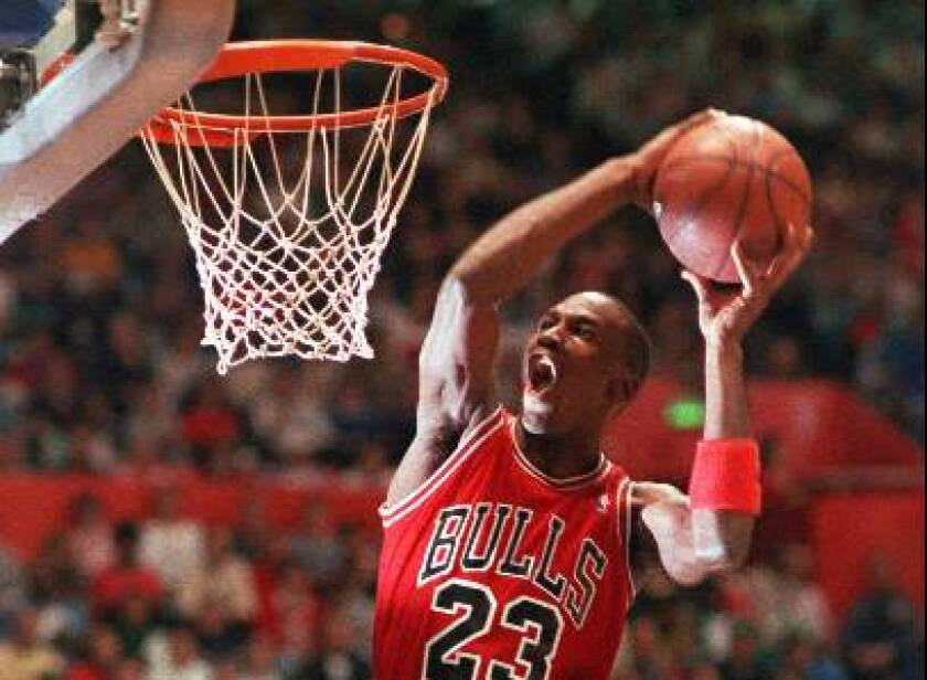Chicago Bulls' Michael Jordan takes part in the NBA All-Star Slam Dunk contest in Seattle on Feb. 7, 1987