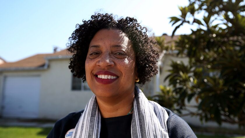 Robin Coste Lewis in front of her childhood home in Compton.