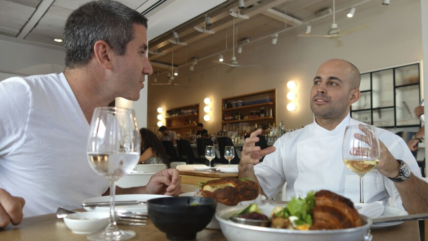 """Israeli American chef and restaurateur Michael Solomonov, left, and chef Meir Adoni at his Mizlala restaurant in the documentary """"In Search of Israeli Cuisine."""""""