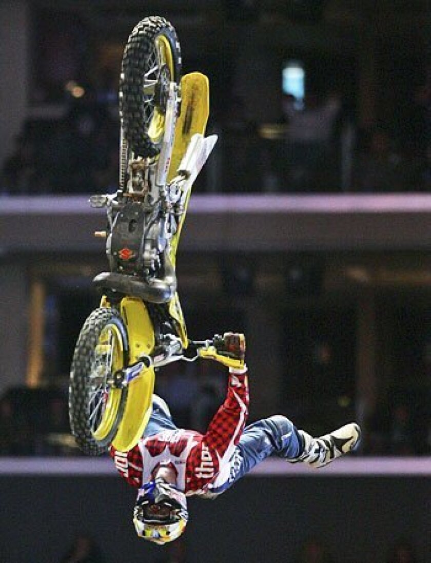 After skipping last year's Moto X competition, Travis Pastrana is back in  Best Trick.  (2006 file photo / Getty Images)