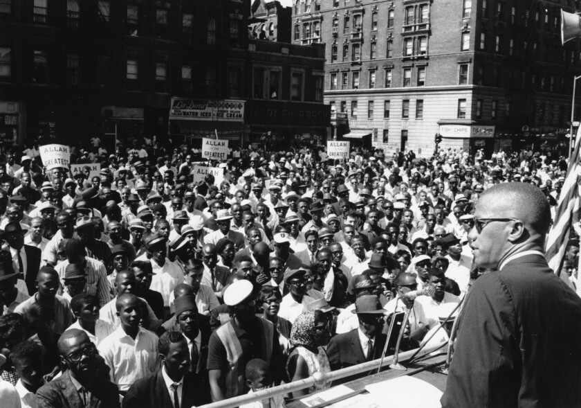 Malcolm X addresses a rally in Harlem.