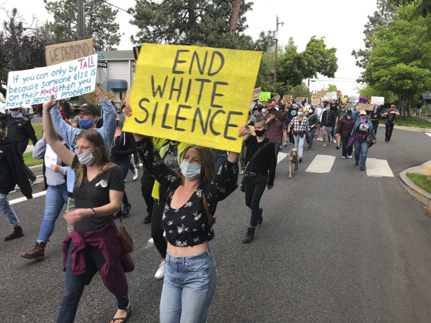 Demonstrators march Saturday, June 6, 2020, in Bend, Ore., to protest racism and police brutality. (AP Photo/Andrew Selsky)