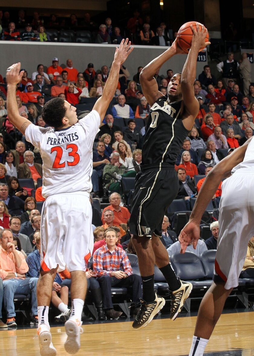 Wake Forest guard Codi Miller-McIntyre (00) shoots next to Virginia guard London Perrantes (23) during the first half of an NCAA college basketball game Wednesday, Jan. 8, 2014, in Charlottesville, Va. (AP Photo/Andrew Shurtleff)