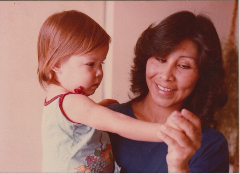 Kat Von D as a baby, held by her mother, Sylvia Galeano.