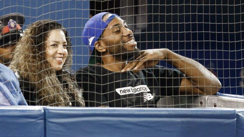 Toronto Raptors' Kawhi Leonard and his girlfriend, Kishele Shipley, watch the Toronto Blue Jays play