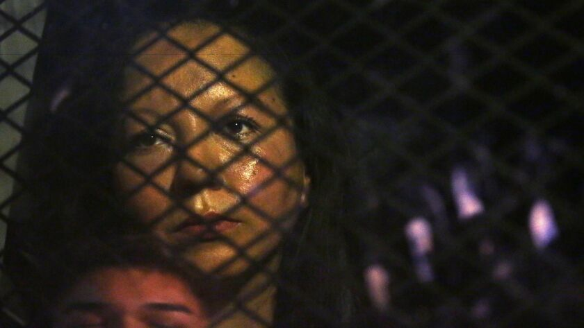 Guadalupe Garcia de Rayos is locked in a van blocked by protesters outside the Immigration and Customs Enforcement field office in Phoenix on Wednesday night.