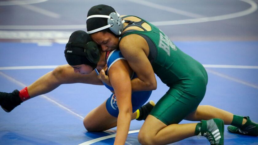 Destiny Lyng (right) wrestles Clairemont's Daniela Ruiz on Feb. 11 during the San Diego Section CIF championships at Clairemont High.