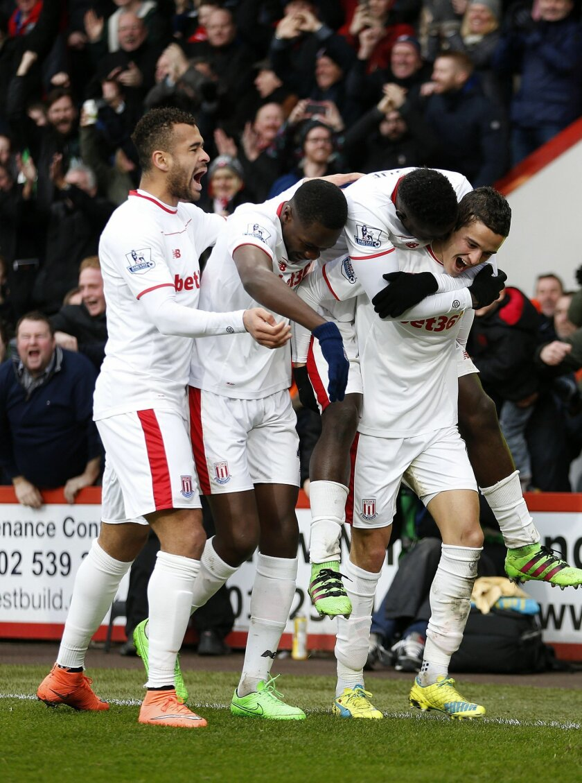 Stoke City's Ibrahim Afellay, right, celebrates scoring against Bournemouth during the English Premier League soccer match at the Vitality Stadium, Bournemouth, England, Saturday Feb. 13, 2016. (Steve Paston/PA via AP) UNITED KINGDOM OUT