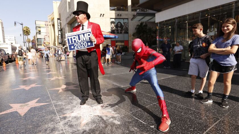 Spiderman assists Gregg Donovan former Hollywood ambassador making sure nobody steps into the crater