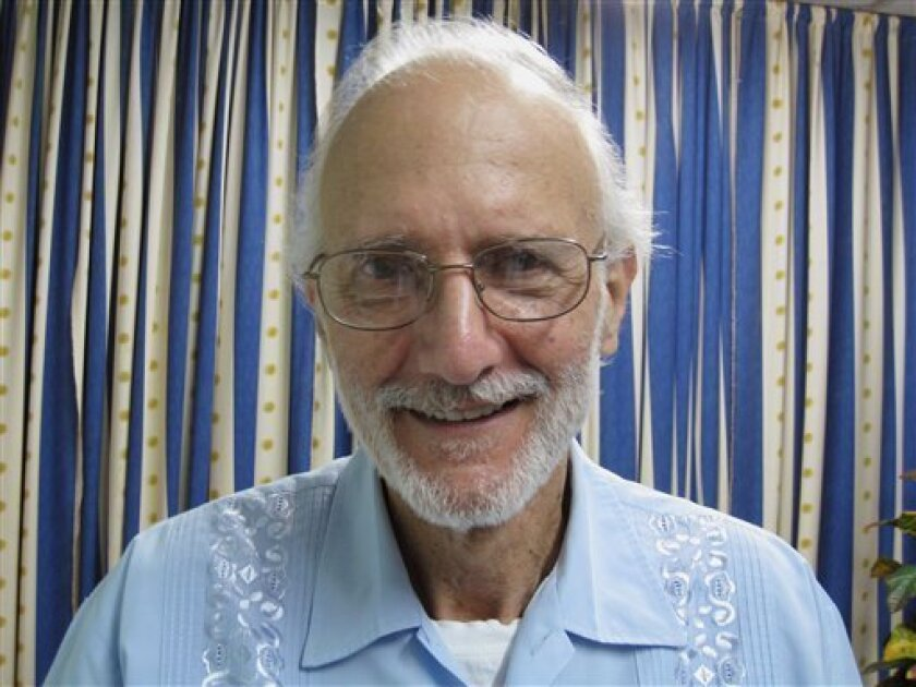 FILE - In this Nov. 27, 2012 file photo provided by U.S. lawyer James L. Berenthal, jailed American Alan Gross poses for a photo during a visit by Rabbi Elie Abadie and Berenthal at Finlay military hospital in Havana, Cuba. The top Cuban diplomat for North American affairs on Wednesday, Dec. 5, 2012, accused Washington of lying about the health and confinement conditions of Gross, a U.S. government subcontractor imprisoned on the island. Gross is three years into a 15-year sentence for crimes against the Cuban state in a case that has chilled already frosty relations between the two nations. (AP Photo/James L. Berenthal, File)