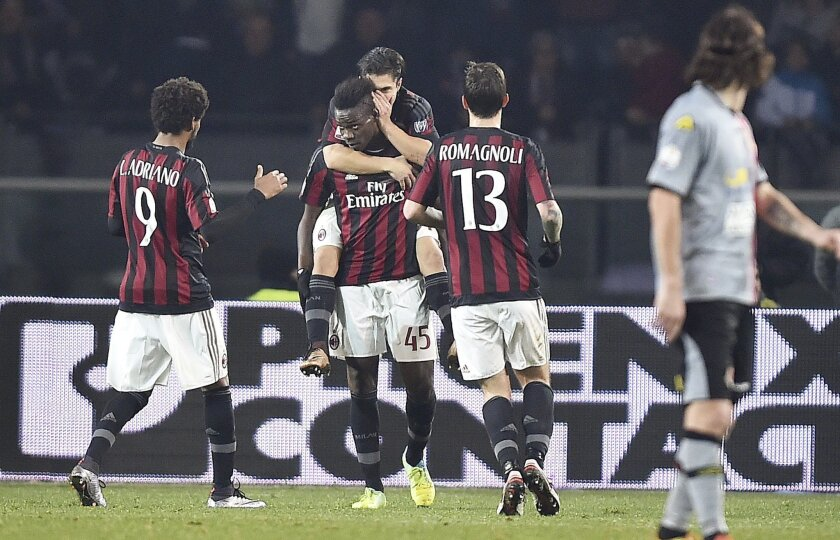 AC Milan's Mario Balotelli, second from left, celebrates with teammates after scoring during the Italian Cup first-leg, semifinal match between Alessandria and AC Milan, at the Turin Olympic stadium, Italy, Tuesday, Jan. 26, 2016. (Alessandro Di Marco/ANSA via AP)