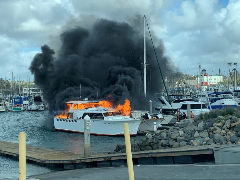 Two boats caught fire Monday afternoon at the Oceanside harbor. One was destroyed and the other was severely damaged.