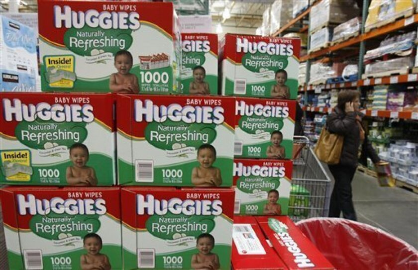 In this photo made Tuesday, Dec. 8, 2009, Huggies baby wipes, a Kimberly-Clark product, are seen on display at Costco in Mountain View, Calif. Kimberly-Clark said Friday, Jan. 22, 2010. price hikes for things like Huggies diapers helped to lift profits in the fourth quarter.(AP Photo/Paul Sakuma)