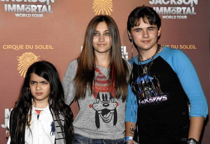 Michael Jackson's children Blanket, Paris and Prince Michael, shown in 2012. In court Wednesday, Prince described the chaos that erupted in the Jackson home when his father died.