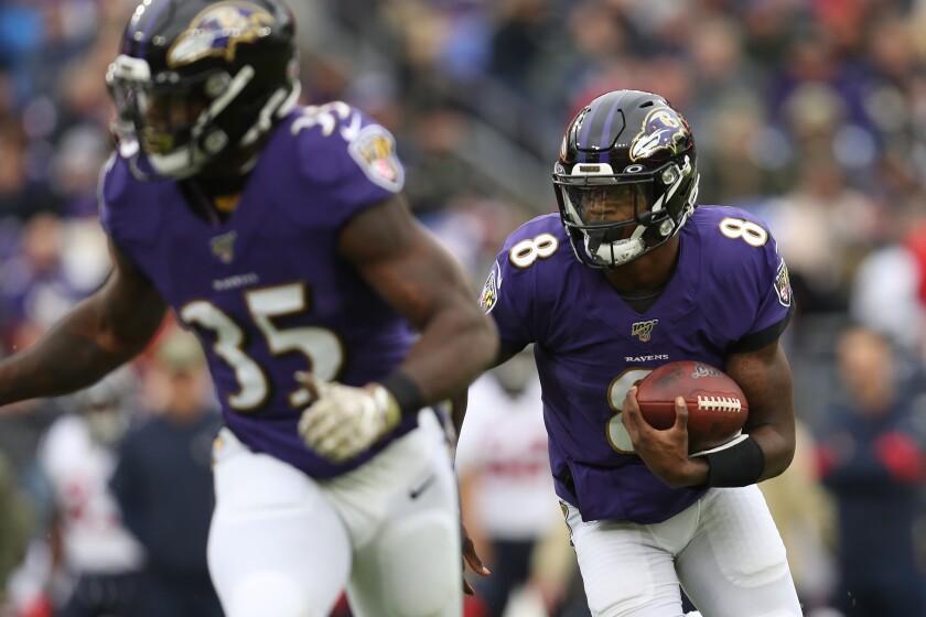 Ravens quarterback Lamar Jackson runs against the Texans during a game Nov. 17 at M&T Bank Stadium.