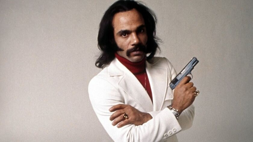 """Actor Ron O'Neal poses for the Warner Bros. movie """"Super Fly"""" circa 1972."""