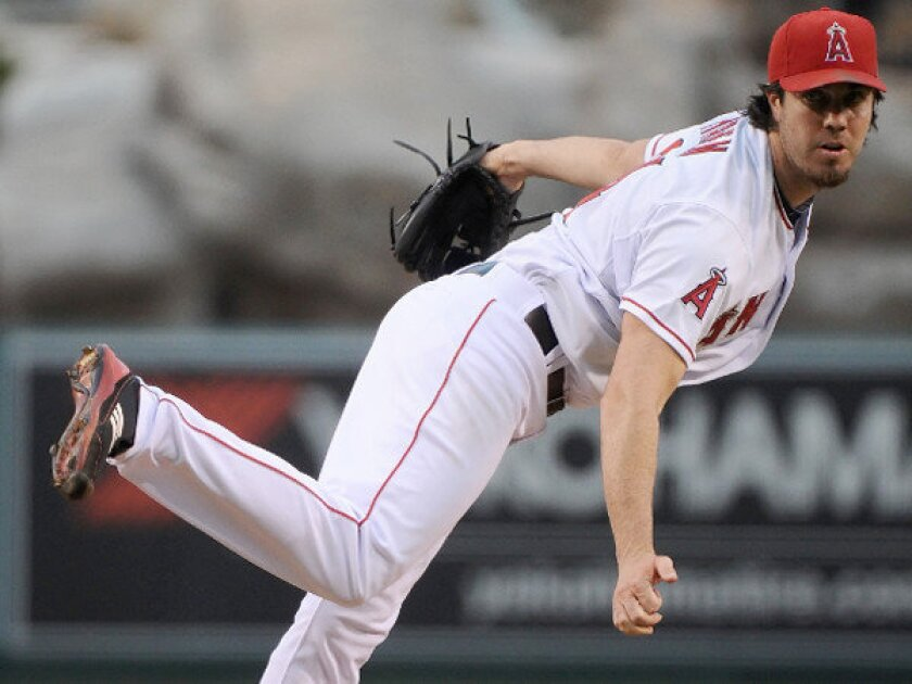 Dan Haren pitched six-plus innings for his fourth victory in five starts as the Angels defeated the Chicago White Sox, 4-2, in September.